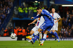Chelsea Midfielder Eden Hazard (BEL) shoots during the second half of the match - Photo mandatory by-line: Rogan Thomson/JMP - Tel: 07966 386802 - 18/09/2013 - SPORT - FOOTBALL - Stamford Bridge, London - Chelsea v FC Basel - UEFA Champions League Group E