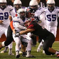 (Photograph by Bill Gerth for SVCN) Westmont #90 Silver Ponce and #71 John Bayley make the tackle vs Soledad in the CCS Division 4 Championship Football Game at Independence High School, San Jose CA on 11/26/16.  (Westmont 13  Soledad 17)