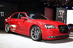 """12 February 2015:  2015 CHRYSLER 300 SPORT: MoPar fans visiting the 2015 Chicago Auto Show will be checking out the many refinements to the 2015 Chrysler 300 four-door sedan. Visually, the body is even more sculptural and expressive with bolder front grille, signature LED lighting, unique finishes and new wheel designs. Finishing the new 300 sedan's powerful rear stance is a new sculpted LED taillamp with an illuminated halo. All-new five-passenger interior includes a standard seven-inch full-color driver info display and class-exclusive electronic rotary transmission shifter. The popular Chrysler 300 is available in four highly equipped models: 300 Limited, 300S, 300C and 300C Platinum. The Chrysler 300 SRT8 is covered separately. For 2015, the Chrysler 300S combines an even more """"blacked out"""" look and new Ambassador Blue sport interior, with benchmark levels of quality, technology and craftsmanship. Large 20-inch polished-face wheels are for rear-wheel drive only, and the 19-inch with all-wheel drive, provides the sedans with an even more planted and road-holding look. Also, the Chrysler 300 AWD model offers even more all-season capability, and includes an exclusive active transfer case and front-axle disconnect for greater fuel economy. New 2015 Chrysler 300 rear-wheel drive or AWD models with the 292 horsepower (300 horsepower on 300S model) 3.6-liter Pentastar V-6 engine continue to use the TorqueFlite eight-speed transmission. Optional powerplant on all 300 models is the 363-hp 5.7L Hemi V-8. Beats by Dr. Dre audio technology that includes a 522-watt 12-channel amplifier is standard on the Chrysler 300S and available on other 300 models. Every '15 Chrysler 300 variant is outfitted with a tailored trunk that can handle 16.3 cubic feet of luggage.<br /> <br /> First staged in 1901, the Chicago Auto Show is the largest auto show in North America and has been held more times than any other auto exposition on the continent. The 2015 show marks the 107th edition of """