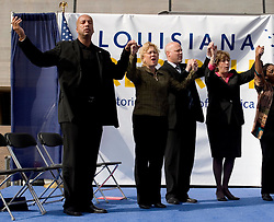 01 January, 2006. New Orleans, Louisiana. Post Katrina aftermath.<br /> New Year's Day in New Orleans, Louisiana. Louisiana Rebirth interfaith service at the Superdome rings out the old disastrous 2005 and rings in what politicians and locals hope will be a successful 2006. Politicians (from left) Mayor Ray Nagin, US Senator Mary Landrieu, Lieutenant Governor Mitch Landrieu and Governor Kathleen Blanco give praise for a better year with religious leaders.<br /> Photo; ©Charlie Varley/varleypix.com