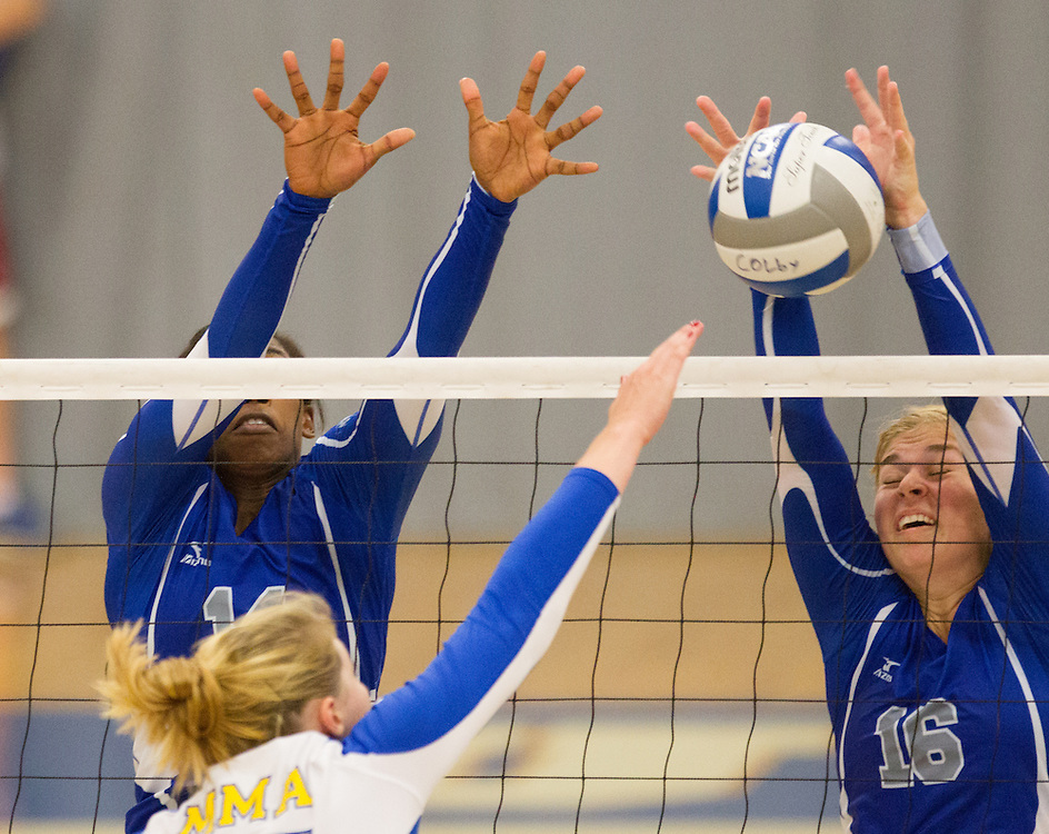 Sarah Arvidson and Kim Donaldson, of Colby College, during an NCAA Division III volleyball match against Maine Maritime Academy at The Whitmore-Mitchell at Wadsworth Gymnasium, Saturday Sep. 6, 2014 in Waterville, ME.  (Dustin Satloff/Colby College Athletics)