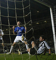 Photo: Andrew Unwin.<br />Newcastle United v Everton. The Barclays Premiership. 25/02/2006.<br />Everton's James Beattie (L) cannot believe it as Newcastle's Emre (R) stops the ball on the goal-line.