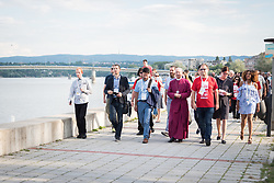 "3 June 2018, Novi Sad, Serbia: Participants of the CEC assembly gather in a peace prayer on the Danube.  Commemoration, forgiveness, and hope were at the focus of the prayer. A procession of delegates and participants started at the memorial commemorating the victims of the raid on Novi Sad in January 1942 during World War II. Hungarian armed forces occupying the region killed 1,246 civilians of the city, mainly Serbs and Jews, throwing their bodies into the Danube. The procession then passed underneath Varadinski Bridge and ended at the newly constructed Žeželj Bridge. At the end of the procession four trees were planted near Žeželj Bridge as a sign of hope and reconciliation. The Conference of European Churches General Assembly takes place on 31 May - 6 June 2018, in Novi Sad, Serbia. More than 400 delegates, advisors, stewards, youth, staff, and distinguished guests take part in the 2018 General Assembly and related events. Gathered together under the theme, ""You shall be my witnesses,"" the assembly forges the path for CEC for the coming five-year period and beyond. Of central concern is the future of Europe in light of economic, political, and social crises and how the churches will live out a vision of witness, justice, and hospitality within this context."