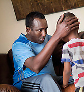 HOPKINS, MN - APRIL, 27: Tahlil Wehlie, left, speaks with his son Luqman, 3, at their apartment in Hopkins, Minn., Thursday April 27, 2017. Luqman and his sister got the measles during the current outbreak in Minneapolis and are now recovering at home. Wehlie's wife had made the decision to forego the shot for her youngest children because she had heard it could cause autism. She has since changed her mind and believes it is important for children to be vaccinated.