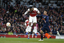 BRITAIN-LONDON-FOOTBALL-UEFA EUROPA LEAGUE-ARSENAL VS VALENCIA.(190502) -- LONDON, May 2, 2019  Arsenal's Alexandre Lacazette (L) heads the second goal during the UEFA Europa League semi-final first leg match between Arsenal and Valencia at The Emirates Stadium in London, Britain on May 2, 2019. Arsenal won 3-1.  FOR EDITORIAL USE ONLY. NOT FOR SALE FOR MARKETING OR ADVERTISING CAMPAIGNS. NO USE WITH UNAUTHORIZED AUDIO, VIDEO, DATA, FIXTURE LISTS, CLUB/LEAGUE LOGOS OR ''LIVE'' SERVICES. ONLINE IN-MATCH USE LIMITED TO 45 IMAGES, NO VIDEO EMULATION. NO USE IN BETTING, GAMES OR SINGLE CLUB/LEAGUE/PLAYER PUBLICATIONS. (Credit Image: © Matthew Impey/Xinhua via ZUMA Wire)