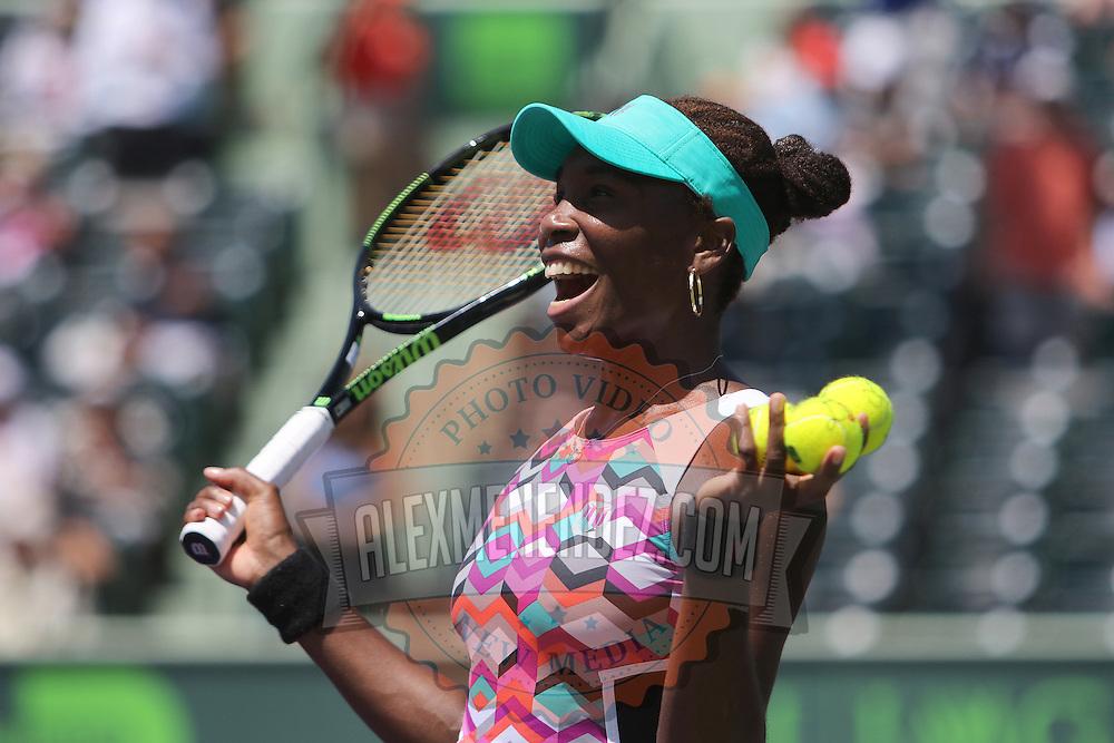 Venus Williams of the United States celebrates her win over Caroline Wozniacki of Denmark during their match at the Miami Open tennis tournament at Crandon Park on Monday, March 30, 2015 in Key Biscayne, Florida. (AP Photo/Alex Menendez)