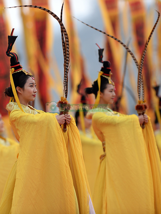 April 4, 2017 - Huangling, Shaanxi, China - Performers dance during a memorial ceremony to worship ''Yellow Emperor'' who according to legend reigned nearly 5,000 years ago and is regarded as the ancestor of all Chinese people. Over 10,000 people attended the ceremony on Tuesday which is also the Qingming Holiday, or the Tomb-Sweeping Day. (Credit Image: © Li Yibo/Xinhua via ZUMA Wire)