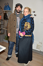 BAY GARNETT and TOM CRAIG at a party hosted by Melissa Del Bono to celebrate the launch of her Meli Melo flagship store at 324 Portobello Road, London W10 on 28th November 2013.