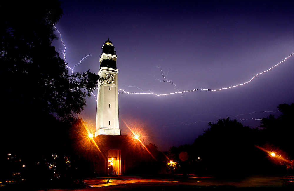 Lightning strikes illuminate the sky behind the Louisiana State University Bell Tower.
