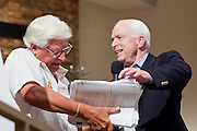 Aug, 25, 2009 -- SUN CITY, AZ: RON MAHONEY from Sun City, AZ, holds a copy of the health care bill while SEN JOHN MCCAIN helps him flip through it during the Town Hall meeting on health care sponsored by Sen McCain at Grace Bible Church in Sun City, AZ, Tuesday. More than 1,000 people attended the meeting in the church, which seats 700. Sun City is a staunchly Republican suburb of Phoenix and most of the crowd was opposed to President Obama health care reform efforts.     Photo by Jack Kurtz