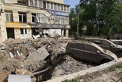 May 29, 2017 - Kiev, Ukraine - A general view of the site of a water pipeline accident in Kiev, Ukraine, on 29 May 2017. Several cars and windows of an apartment block were damaged by pieces of asphalt and soil by water pressure, at the cause a water pipeline accident in Kiev. (Credit Image: © Serg Glovny via ZUMA Wire)