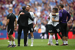 Derby County manager Frank Lampard, Richard Keogh, and players after the final whistle