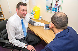 Pictured: Miles Briggs took the opportunity to get his blood pressure checked today.<br /> <br /> The shadow health secretary Miles Briggs and public health spokesman Annie Wells visited Dears Pharmany in Oxgangs, Edinburgh, today to announce the initiative to make pharmacies a key partner in primary health care.  <br /> <br /> Ger Harley | EEm 27 July 2018