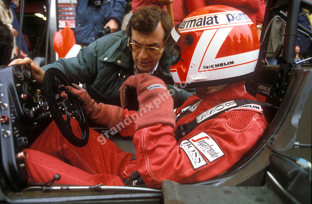 Niki Lauda and a McLaren TAG-Porsche engineer in the pits during practice for the 1984 European Grand Prix at the Nurburgring. Photo: Grand Prix Photo