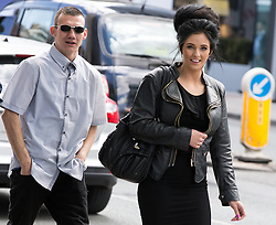 "© Licensed to London News Pictures . 13/05/2015 . Manchester , UK . Chantelle Partington (r) and Ian Oldham (l) outside Manchester Magistrates Court today (13th May 2015) . The pair are jointly charged with a Section 4a Public Order Offence , namely using threatening, abusive, insulting words or behaviour to cause harassment alarm or distress , after Jean Claude Manseau suffered homophobic verbal abuse on a Manchester City Centre tram on 1st November 2014 . The abuse is reported to have been prompted by Manseau and his friend Jake Heaton singing a tune from the show "" Wicked "" . Following this they were physically assaulted on the street by between 10 and 20 people , none of whom have been identified . The incident prompted a campaign by the Manchester Lesbian and Gay Chorus which saw protesters singing on City Centre trams under the banner of "" Safe to Sing "" . Photo credit : Joel Goodman/LNP"