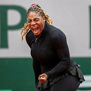 PARIS, FRANCE September 28. Serena Williams of the United States reacts to a point during her match against Kristie Ahn of the United States in the first round of the singles competition on Court Philippe-Chatrier during the  French Open Tennis Tournament at Roland Garros on September 28th 2020 in Paris, France. (Photo by Tim Clayton/Corbis via Getty Images)