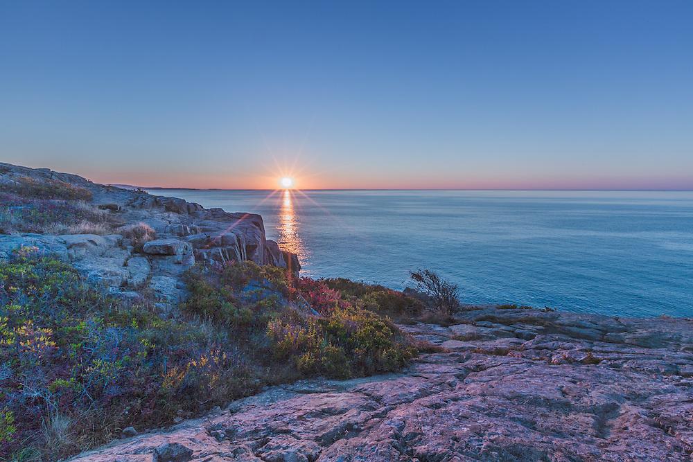 Sunrise over the Atlantic Ocean at Acadia National Park in Maine.
