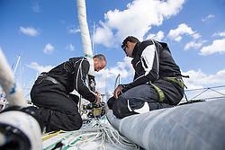 Damian Foxall (IRL) and Yassir Al Rahbi (OMA) prepare the J1's furler on Oman Sail's MOD70 Musandam during Kiel week 2014, 22-06-2014, Kiel - Germany.