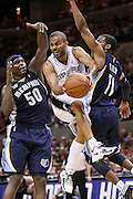 Apr 17, 2011; San Antonio, TX, USA; San Antonio Spurs guard Tony Parker (center) passes the ball under the basket against Memphis Grizzlies forward Zach Randolph (left) and guard Mike Conley (right) during the first half of game one of the first round of the 2011 NBA playoffs at the AT&T Center. Mandatory Credit: Soobum Im-US PRESSWIRE