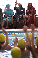 File photo dated 16/07/15 of Queen Elizabeth II (top left) and the Duke of Edinburgh (top centre) watching a demonstration of swimming activities by local school children during a visit to the Abbey Leisure Centre in Barking as part of celebrations to mark Barking and Dagenham's 50th anniversary as a London Borough. Prince Philip's final public engagement takes place on Wednesday, before he retires at the age of 96.