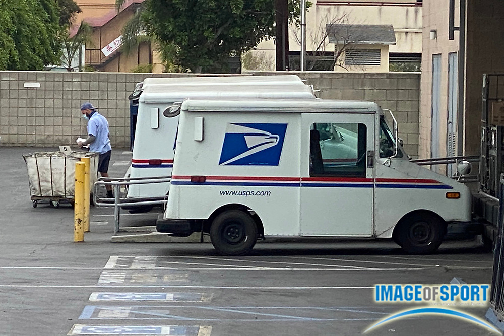 A general view mail trucks at the United States Postal Service office, Saturday, Sept. 26, 2020, in Monterey Park, Calif.