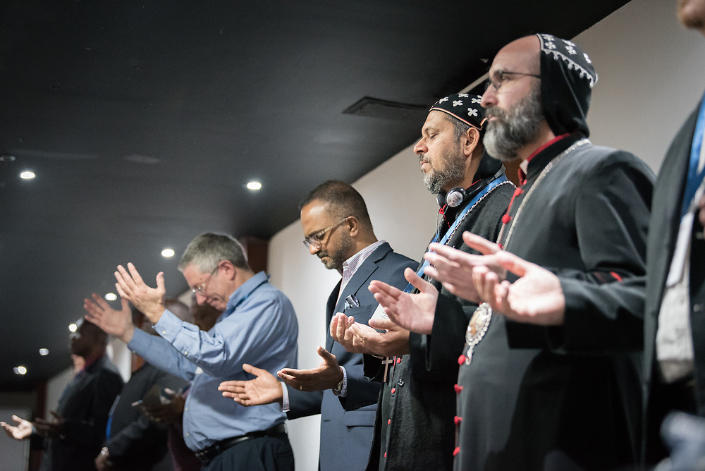 """26 April 2018, Bogotá, Colombia: The Global Christian Forum gathers in Bogotá on 24-27 April 2018 under the theme of """"Let mutual love continue"""". Here, morning prayers led by the Pentecostal World Fellowship, with the Assemblies of God, Colombia."""