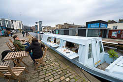 Small cafe inside narrowboat on Union Canal at Fountainbridge in Edinburgh , Scotland, United Kingdom.