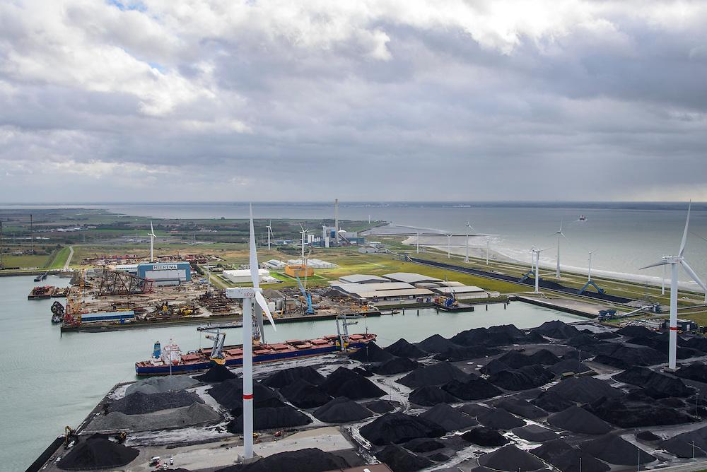 Nederland, Zeeland, Borssele, 23-10-2013; energielandschap, haven bij Borssele. Opslag van steenkool, windmolens aan de dijk van de Westerschelde met o.a. het oranje gebouw van COVRA (Centrale Organisatie Voor Radioactief Afval) , kerncentrale Borssele middenboven. <br /> Port and  industrial area with storage of coal and COVRA, a company that handles the storage of radioactive waste. In the back nuclear plant Borssele (m).<br /> luchtfoto (toeslag op standaard tarieven);<br /> aerial photo (additional fee required);<br /> copyright foto/photo Siebe Swart.).<br /> luchtfoto (toeslag op standaard tarieven);<br /> aerial photo (additional fee required);<br /> copyright foto/photo Siebe Swart.