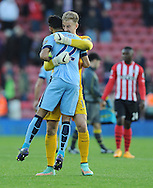 Manchester City goalkeeper Joe Hart celebrates with team mate Gael Clichy of Manchester City at the end of the game<br /> - Barclays Premier League - Southampton vs Manchester City - St Mary's Stadium - Southampton - England - 30th November 2014 - Pic Robin Parker/Sportimage