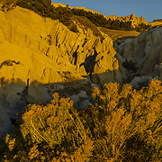 Dawn light on scenic Ancient Hunters area in Badlands National Park, SD.