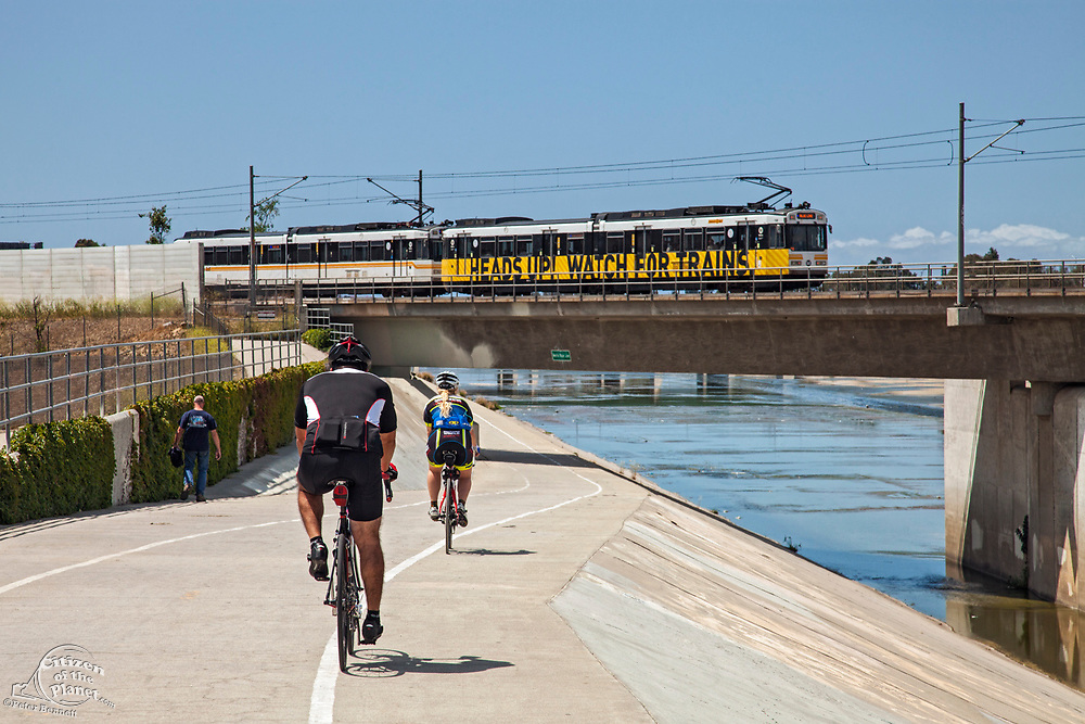 Los Angeles Metro Rail going over bike path along Los Angeles River, Long Beach, California, USA
