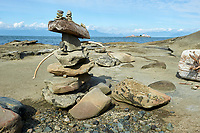 Rocks made into an Inukchuk (Inukshuk, Inuksuk) on beach at Orlebar Point, Gabriola Island, BC, Canada