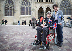 © Licensed to London News Pictures. 06/06/2014. Bayeux, Normandy.  William Snelling (11) arrives with his Grandfather, DDay Veteran Tony Snelling (91) from Horsham, West Sussex.  They joined veterans and their guests at the Royal British Legions 70th Anniversary service of the D Day landings in the cathedral at Bayeux this morning.  The majority of the 600 veterans attended the service along with HRH The Queen and Prince Phillip.   Photo credit : Alison Baskerville/LNP