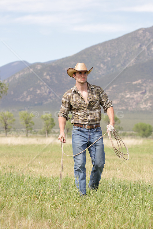 All American cowboy on a ranch with a lasso