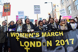 © Licensed to London News Pictures. 21/01/2017. London, UK. Tens of thousands of women take part in the Women's March in central London.  The event, alongside others taking place worldwide, is a protest against gender inequality. Photo credit : Stephen Chung/LNP