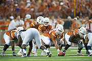 AUSTIN, TX - SEPTEMBER 14: Case McCoy #6 of the Texas Longhorns calls a play at the line of scrimmage against the Mississippi Rebels on September 14, 2013 at Darrell K Royal-Texas Memorial Stadium in Austin, Texas.  (Photo by Cooper Neill/Getty Images) *** Local Caption *** Case McCoy
