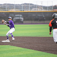 Miyamura second baseman Dante Griego turns a double play by getting the forced out at second base and throwing the runner out at first base in their game Thursday, April 11 against Gallup at Miyamura High School.