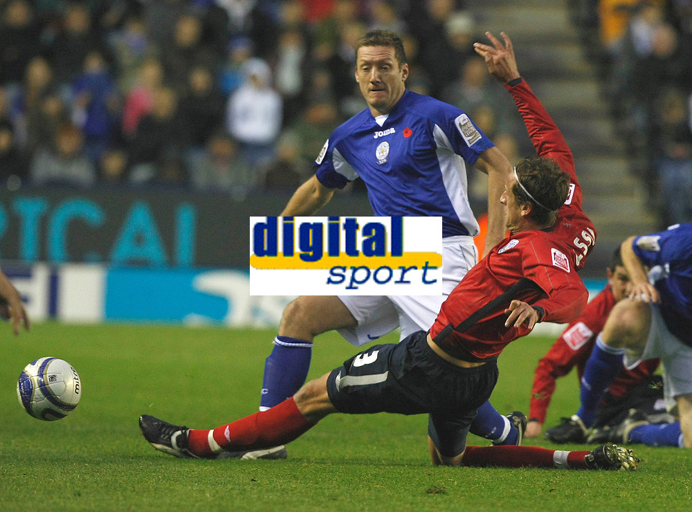 Photo: Steve Bond/Richard Lane Photography. Leicester City v West Bromwich Albion. Coca Cola Championship. 07/11/2009. Jonas Olsson (R) clears the ball in front of Steve Howard