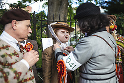 May 4, 2019 - London, London, UK - London, UK. A woman has her bonnet fixed at the start of the annual Tweed Run bicycle ride, in which participants cycle around the capital wearing vintage tweed outfits. (Credit Image: © Rob Pinney/London News Pictures via ZUMA Wire)