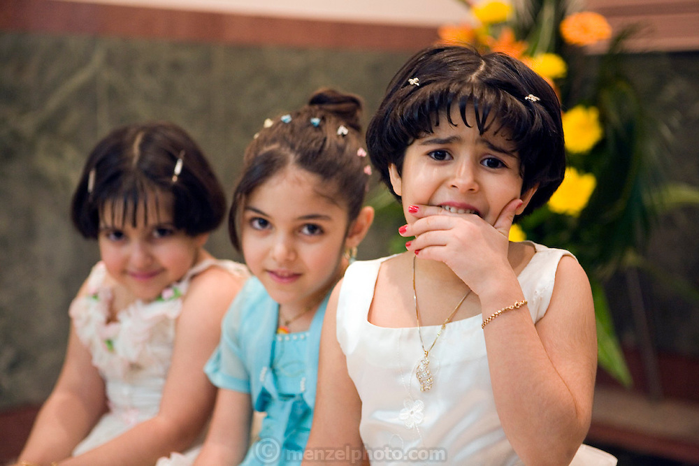 Young girls at a wedding party at the Talar Yazd Restaurant, Yazd, Iran. Traditionally females and males at Muslim weddings celebrate the wedding separately. Photo taken in the women's section of the wedding part by Faith D'Aluisio.