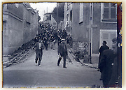 village festivity France 1930s with marching band