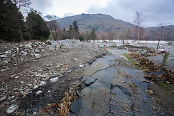 © Licensed to London News Pictures. 08/12/2015. Glen ridding UK. Picture shows what was once a road in Glenridding. The village of Glenridding has been cut of from the outside world for four days with no water, electricity or telephone lines after huge torrents of water from the surrounding mountains destroyed roads leading to it & flooded the village centre. Photo credit: Andrew McCaren/LNP