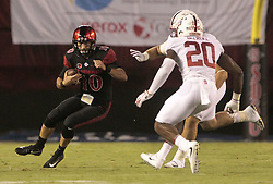 September 16, 2017 - San Diego, CA, USA - San Diego State quarterback Christian Chapman, left, runs the ball as Stanford's Bobby Okereke (20) and Eric Cotton close in during the first quarter  at Jack Murphy Stadium in San Diego on Saturday, Sept. 16, 2017. (Credit Image: © Hayne Palmour Iv/TNS via ZUMA Wire)