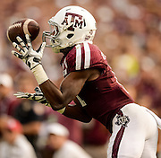 Sep 14, 2013; College Station, TX, USA; Texas A&M Aggies wide receiver Derel Walker (11) stretches for a catch against the Alabama Crimson Tide during the second half at Kyle Field. Mandatory Credit: Thomas Campbell-USA TODAY Sports