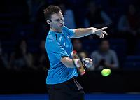 Tennis - 2017 Nitto ATP Finals at The O2 - Day One<br /> <br /> Mens Doubles: Group Eltingh/Haarhus: Henri Kontinen (Finland) & John Peers (Australia) Vs Ryan Harrison (United States) & Michael Venus<br /> <br /> John Peers (Australia) with a return  of serve  (Australia)<br /> <br /> John Peers (Australia) with a <br /> <br /> COLORSPORT/DANIEL BEARHAM