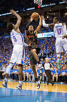 OKLAHOMA CITY, OK - APRIL 21: Rodney Hood #5 of the Portland Trail Blazers drives to the basket against Jerami Grant #9 and Dennis Schroder #17 of the Oklahoma City Thunder during Round One Game Three of the 2019 NBA Playoffs on April 21, 2019 at Chesapeake Energy Arena in Oklahoma City, Oklahoma  NOTE TO USER: User expressly acknowledges and agrees that, by downloading and or using this photograph, User is consenting to the terms and conditions of the Getty Images License Agreement.  The Trail Blazers defeated the Thunder 111-98.  (Photo by Wesley Hitt/Getty Images) *** Local Caption *** Rodney Hood; Jerami Grant; Dennis Schroder