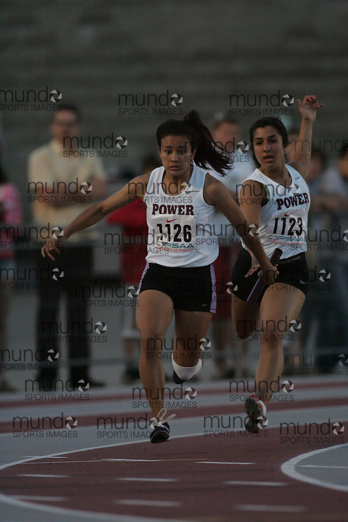 (London, Ontario}---03 June 2010) Julia Soriano of Michael Power/St.Joseph-Etobic competing in the 4x100m relay heats at the 2010 OFSAA Ontario High School Track and Field Championships. Photograph copyright Sean Burges / Mundo Sport Images, 2010.