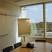 Meeting room at a Glaxo Smith Kline, a health care company in Brentford.  From the series Desk Job, a project which explores globalisation through office life around the World.