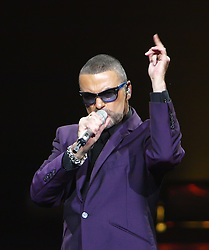 File photo dated 29/09/12 of George Michael in concert at the Royal Albert Hall, London during his Symphonica Tour, as the pop superstar has died peacefully at home, his publicist said.