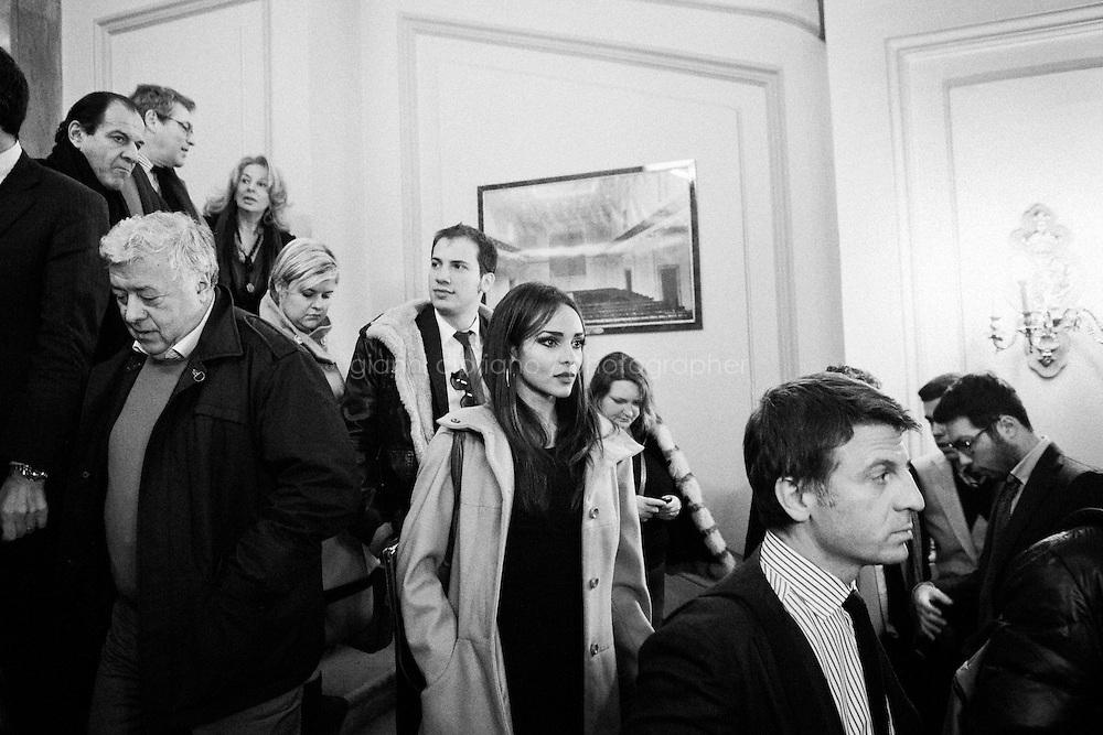 """ROME, ITALY - 24 JANUARY 2013: Participants of Silvio Berlusconi's People of Freedom party convention step outside the Capranica Theatre where the former PM presented the PdL candidates for the upcoming general elections in Rome, on January 25, 2013.<br /> <br /> A general election to determine the 630 members of the Chamber of Deputies and the 315 elective members of the Senate, the two houses of the Italian parliament, will take place on 24–25 February 2013. The main candidates running for Prime Minister are Pierluigi Bersani (leader of the centre-left coalition """"Italy. Common Good""""), former PM Mario Monti (leader of the centrist coalition """"With Monti for Italy"""") and former PM Silvio Berlusconi (leader of the centre-right coalition).<br /> <br /> ###<br /> <br /> ROMA, ITALIA - 24 GENNAIO 2013: I partecipanti alla convention del Popolo della Libertà di Silvio Berlusconi escono dal Teatro alla fine dell'evento in cui l'ex-premier e leader del Popolo della Libertà ha presentato i candidati PdL alle prossime elezioni politiche, a Roma il 24 gennaio 2013.<br /> <br /> Le elezioni politiche italiane del 2013 per il rinnovo dei due rami del Parlamento italiano – la Camera dei deputati e il Senato della Repubblica – si terranno domenica 24 e lunedì 25 febbraio 2013 a seguito dello scioglimento anticipato delle Camere avvenuto il 22 dicembre 2012, quattro mesi prima della conclusione naturale della XVI Legislatura. I principali candidate per la Presidenza del Consiglio sono Pierluigi Bersani (leader della coalizione di centro-sinistra """"Italia. Bene Comune""""), il premier uscente Mario Monti (leader della coalizione di centro """"Con Monti per l'Italia"""") e l'ex-premier Silvio Berlusconi (leader della coalizione di centro-destra).ROME, ITALY - 24 JANUARY 2013: Silvio Berlusconi, former PM and leader of The People of Freedom party, and Angelino Alfano, Secretary of the party, present the PdL candidates for the upcoming general elections during the PdL convention in Rome, on Janua"""